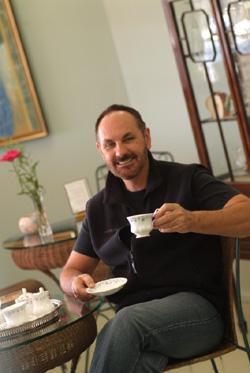Photo of Dr Paddi Lund drinking tea
